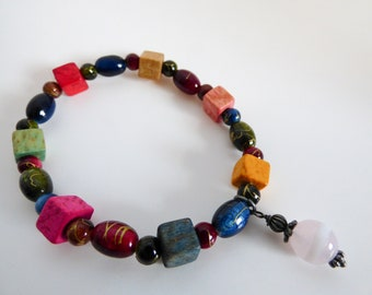 Glass and Wooden Bead Stretch Bracelet With Silver Charm