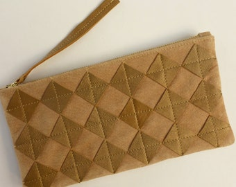 Metallic gold leather zip pouch. Repurposed gold leather diamond chips on ochre suede, brass zipper, fully lined.