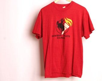 Vintage CASPER WYOMING rouge taille grand COWBOY État jeux doux t-shirt des années 80 vintage