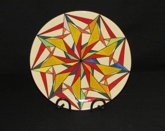 29cm Round platter mainly reds and yellows