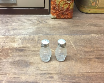Vintage salt and pepper shakers Clear glass hand grenade