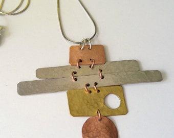 Betty, sterling, copper, brass asymmetric necklace