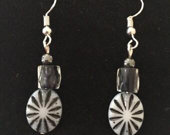 White and black starburst earrings