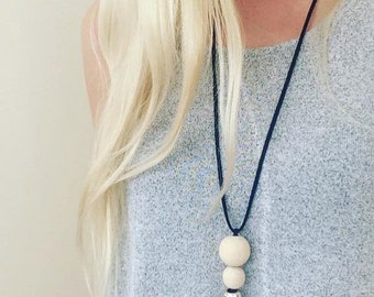Wooden bead necklace strung on a long faux suede cord