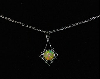 Gorgeous Welo Opal in Delicately Detailed Vintage Antiqued Silver Setting