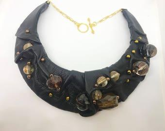 Unique handmade black leather, black, gold, and red quartz, and hematite statement bib necklace