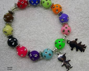 Bracelet with Colored Beads and Silver Children Charms