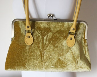 Primrose yellow embossed velvet handbag with a cow parsley