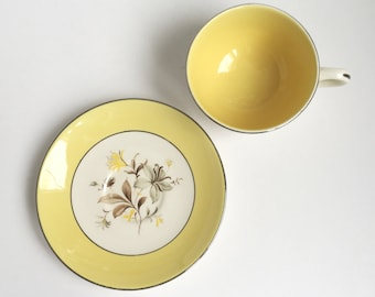 Vintage yellow, grey and brown cup and saucer, silver rimmed