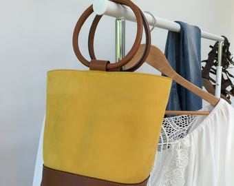 Bucket bag in soft yellow suede with top handles in leather. Summer bag in yellow suede. Cute buclet bag. Perfect gift for Mother's day.