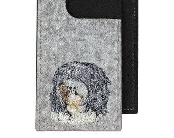 Schapendoes - A felt phone case with an embroidered image of a dog.