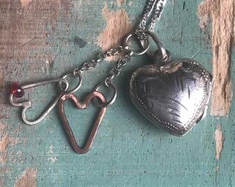 silver engraved heart locket with two hanging hearts
