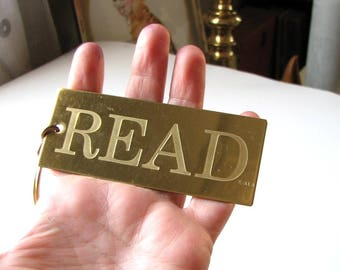 large vintage brass keychain - READ . signed ALA