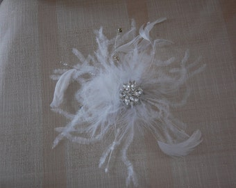 Vintage Bridal Headpiece embellished with feathers,beads and beautiful rhinestone broach with removable birdcage veil.