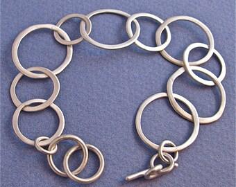 Sterling silver light weight hammered link chain bracelet