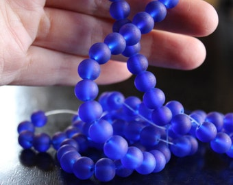100 approx. 8 mm royal blue frosted glass beads, round and smooth, one strand for making jewelry