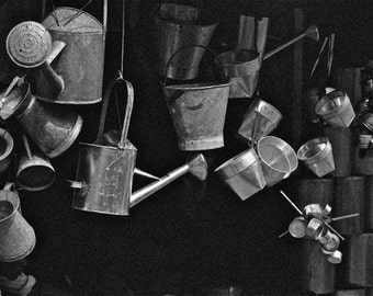 Tin and potsblack and white photograph  Asian abstracted market hanging pots travel