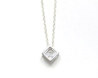 Short dainty sterling silver plated necklace with small cube pendant and diamond shaped rhinestone