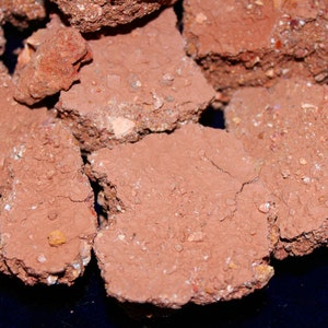 Earthy clay dirt chunks with multicolor clay pieces throughout. Pure and edible clay soil