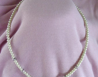 Pearl and pewter necklace with emerald green focal