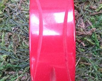 Vintage bakelite deep red carved dress clip