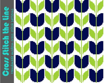 Retro inspired cross stitch pattern of blue tulips. Modern embroidery. Contemporary design ideal for larger projects such as cushion covers.