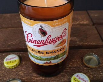 Upcycled Leinenliugel's beer bottle candle. Made with soy wax and orange essential oil. Ready to give as a gift.