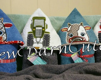 """Hooded towels. Lined-embroidered-appliqued """"peeker characters."""""""