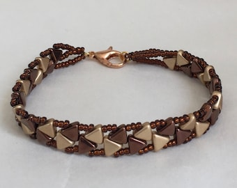 beaded bracelet brown and gold beaded bracelet brown and gold triangle beads in repeating pattern brown seed beads earth tones