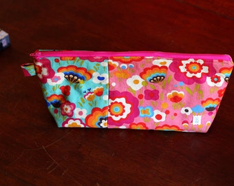 Retro floral clutch, over sized zipper pouch, makeup bag, toiletry bag in delicious colors.