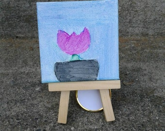 Beautiful tulip painting on canvas.  3 x 3 with easel.