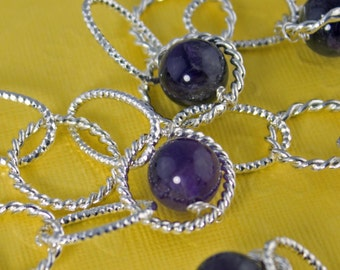 SALE now 80 was 95.   Fancy Silver Link Necklace enhanced with Amethyst Beads