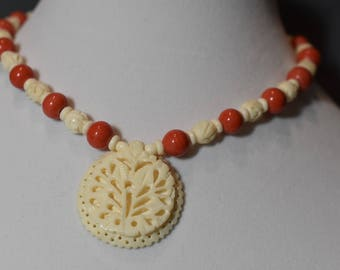 Coral and bone choker with bone pendant