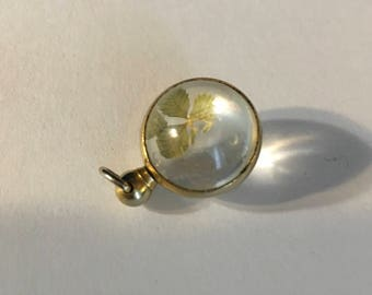 Antique 10k gold pools of light pendant with four leaf clover as found