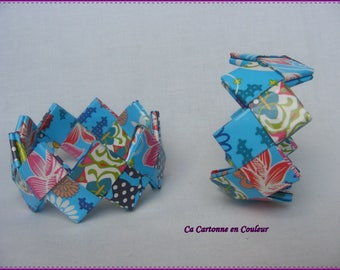 Bracelet closed multicolored paper on blue background