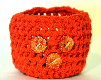 Wrist cuff/Tattoo cover, red spandex and cotton yarn with red sparkle shell buttons from Portugal.
