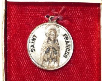 Vintage Creed sterling St. Frances medal in original box.