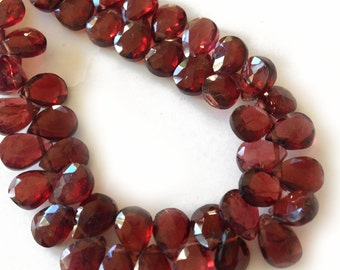 Garnet faceted briolettes.  Approx. 5.25x7-7.25mm.  Select a quantity.
