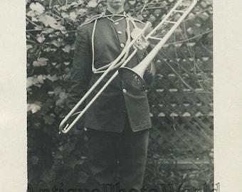 Woman in military uniform w trombone antique photo
