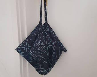 Hand made reversible shoulder bag with vintage linen and traditional Yoruba textile.
