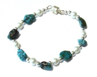 "7"" beaded bracelet with turquoise nuggets, Swarovski pearls, silver beads and magnetic clasp and matching earrings."