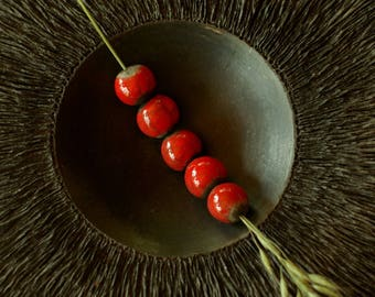 2 raku ceramic beads, terracotta round beads, red enamel, enamelled raku beads on raw and black clay