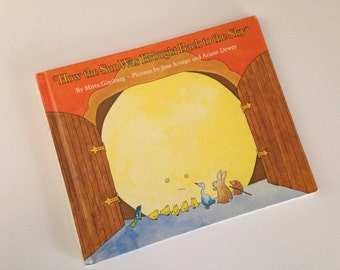 1975 How The Sun Was Brought Back to the Sky - by Mirra Ginsburg - illustrated by Jose Aruego and Ariare Dewey.