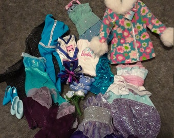 Assorted lot of cool toned Barbie clothes, jacket, dresses, bodysuit, skirts, heels tops, teddy bear