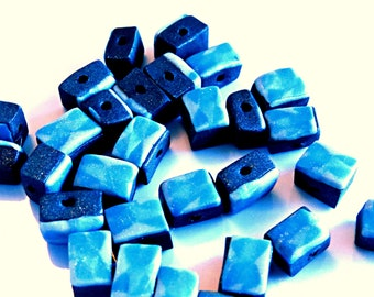 Blue triangular patterned polymer clay beads