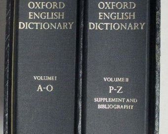 Vintage (1971) Oxford University Press hardcover Compact Edition of the Oxford English Dictionary in case with drawer and magnifier.