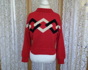 Very gently used. Red cotton intarsia sweater with black and cream diamond pattern. Size S/M.