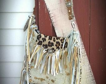 Acid wash cowhide fringe purse