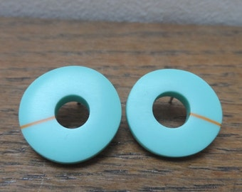 Turquoise w orange stripe 'don't match studs'
