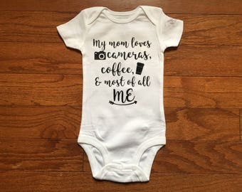 My mom loves cameras, coffee, and most of all me baby bodysuit - perfect for a baby shower gift!